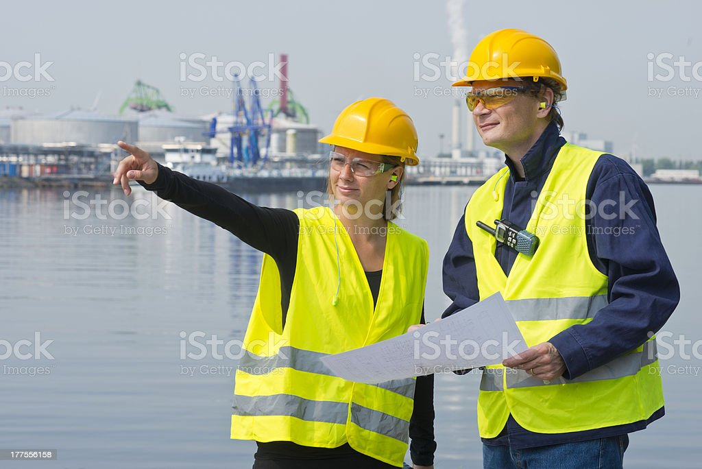 Construction workers in harbor stock photo