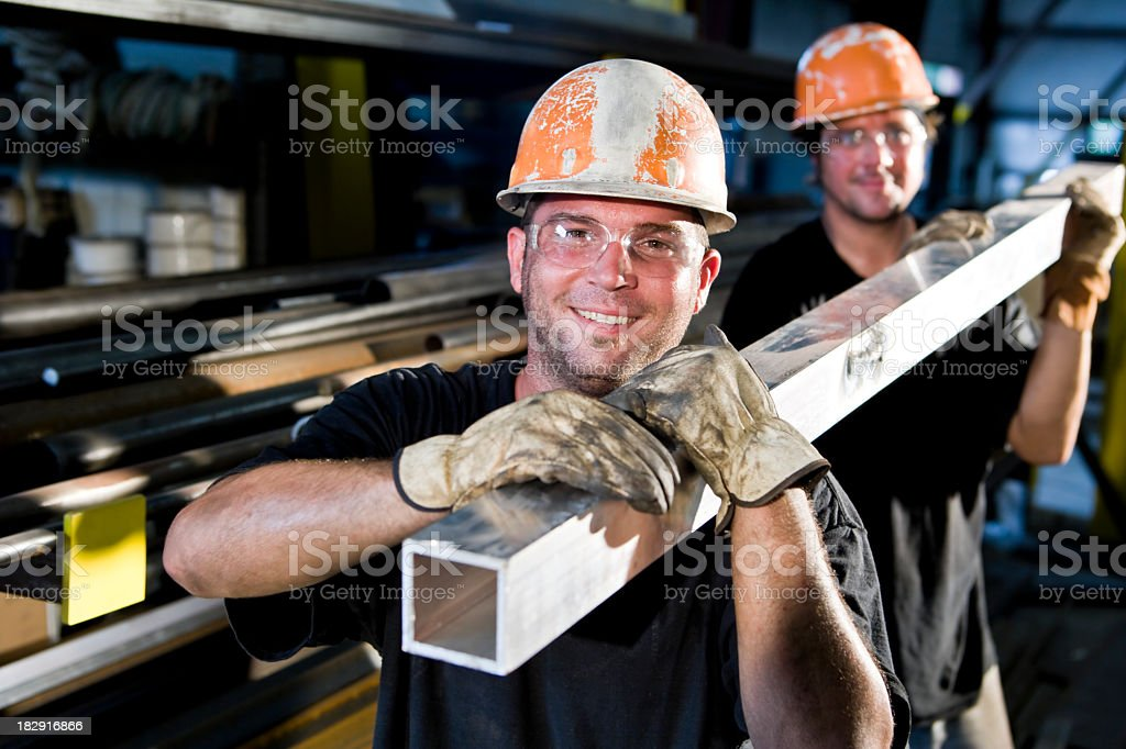 Construction workers in hard hats working stock photo