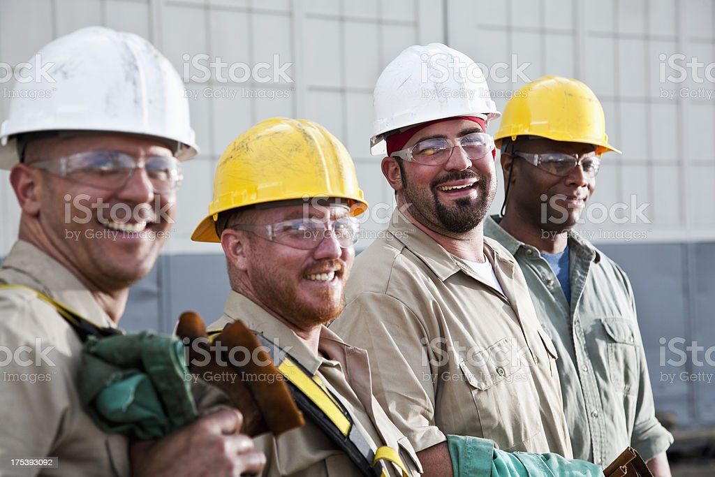 Construction workers in safety gear stock photo