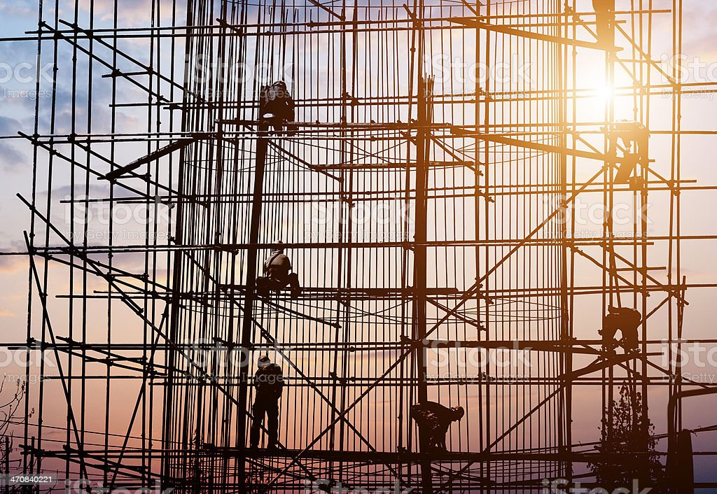 construction workers in the sunset stock photo