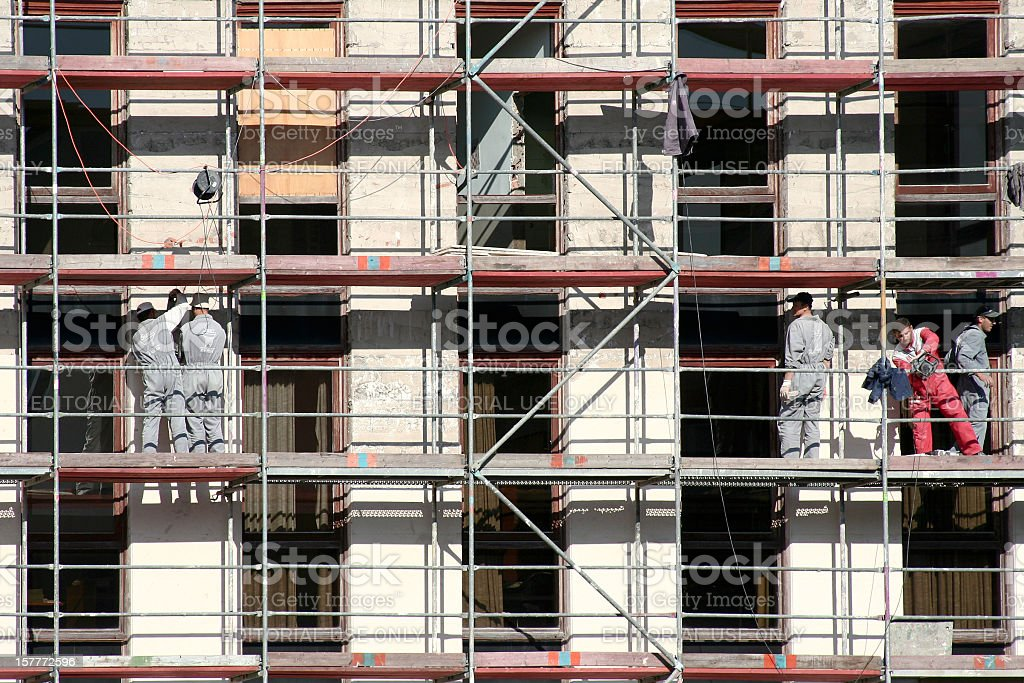 Construction workers on a building royalty-free stock photo