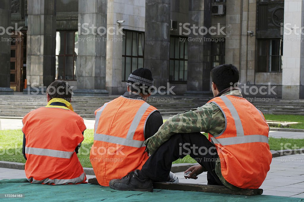 Construction workers on a short break royalty-free stock photo