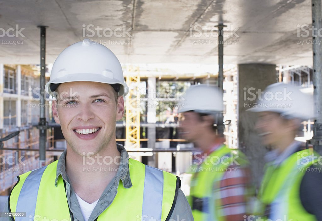 Construction workers on construction site royalty-free stock photo
