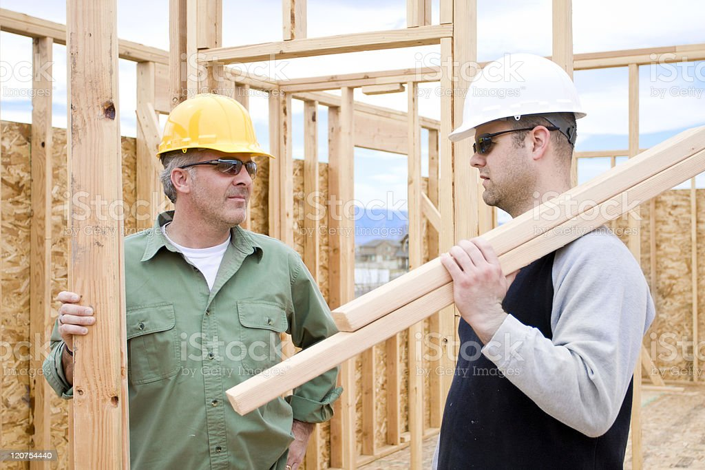 Construction Workers on the job building a home royalty-free stock photo