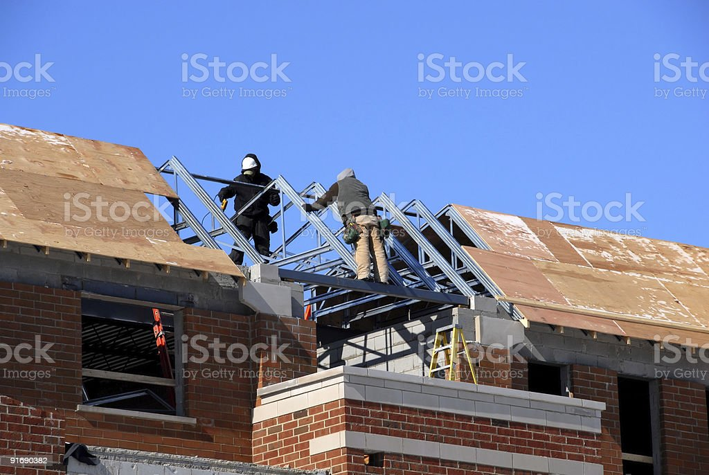 Construction Workers on the Roof royalty-free stock photo