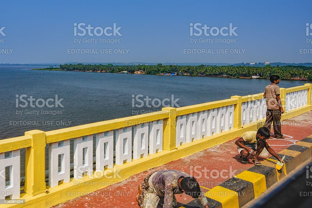Construction workers painting curb stock photo