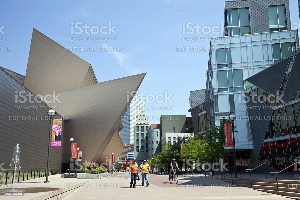 Construction workers passing Denver Art Museum. stock photo