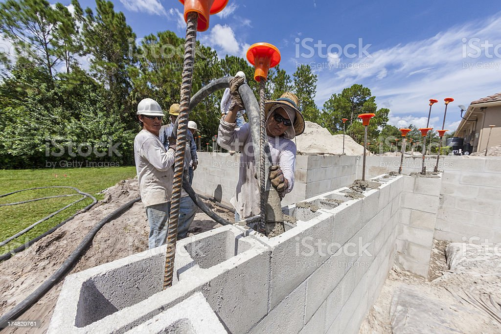 Construction Workers Pouring Concrete on Job Site royalty-free stock photo