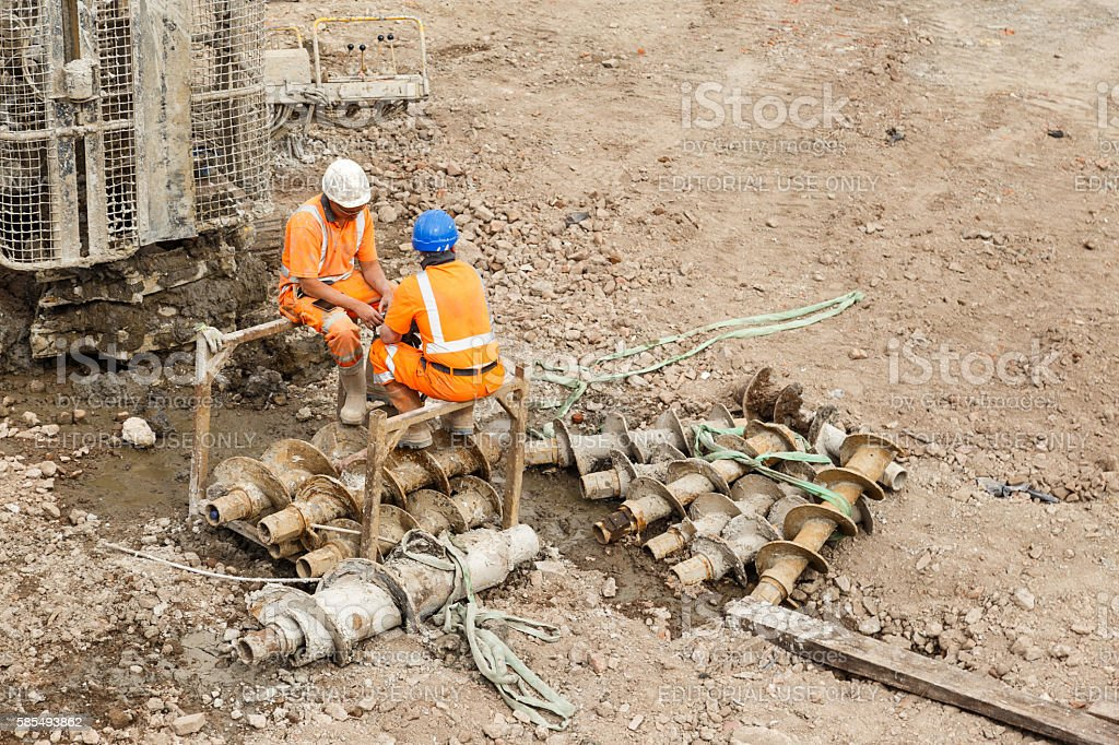 Construction workers sitting stock photo