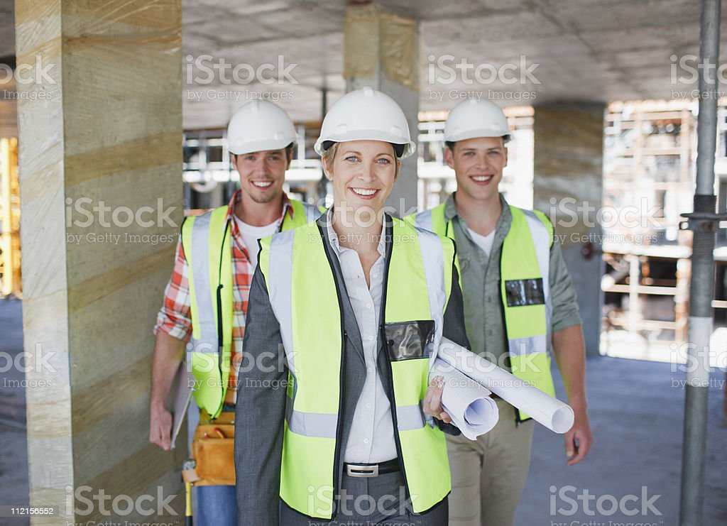 Construction workers standing on construction site royalty-free stock photo