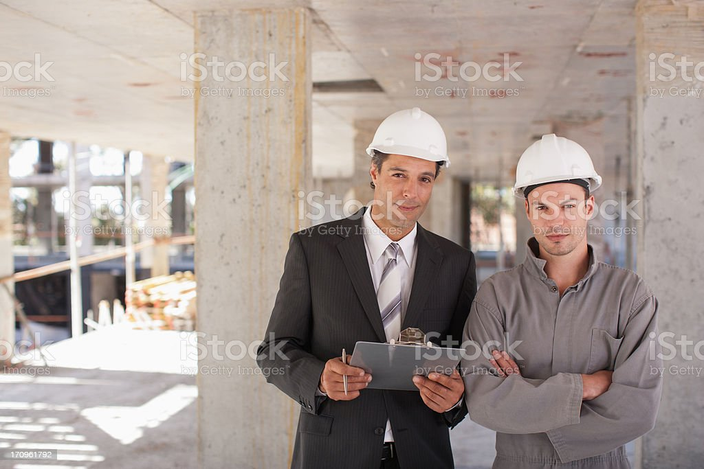 Construction workers standing together on construction site royalty-free stock photo