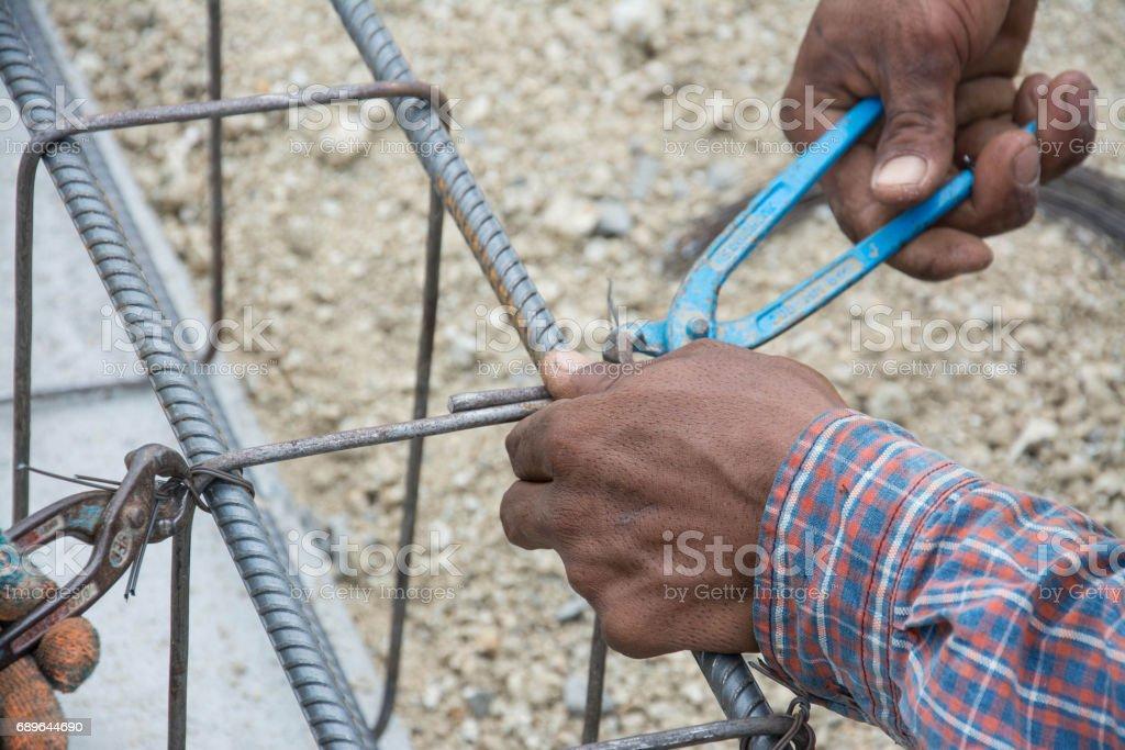 construction workers steel tie stock photo