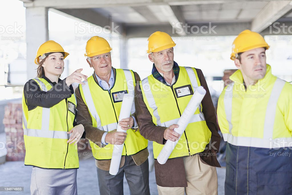 Construction workers talking on site royalty-free stock photo