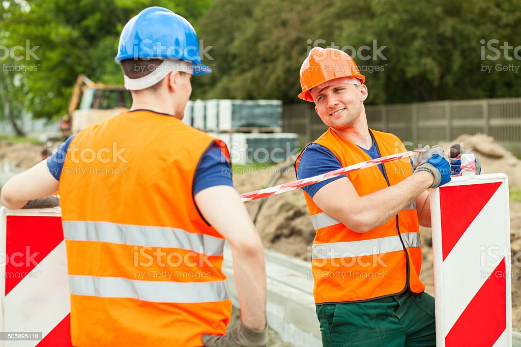 Construction workers talking stock photo