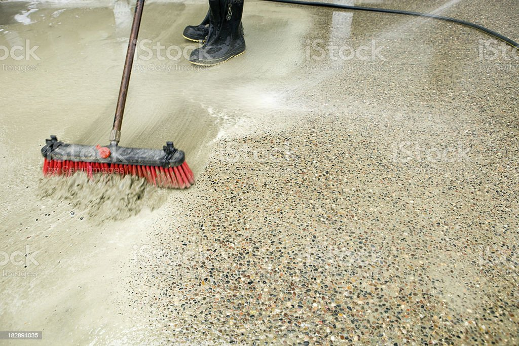 Construction Workers Washing Concrete Patio to Expose Aggregate stock photo