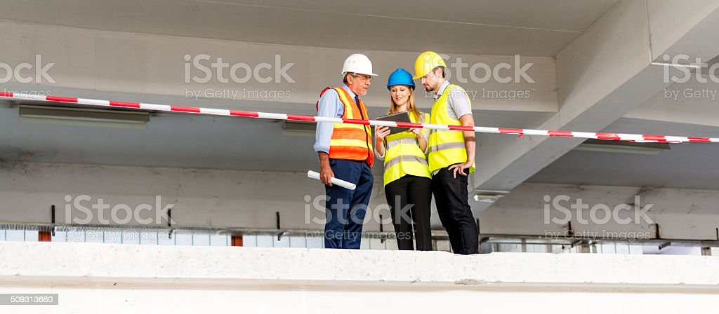Construction workers with digital tablet stock photo