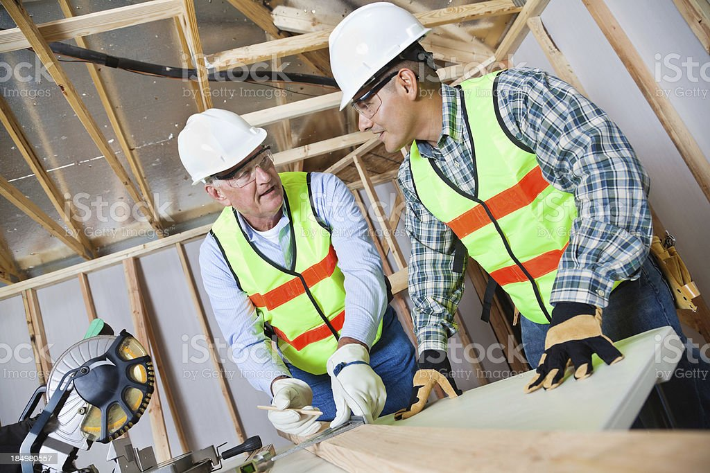 Construction workers working at building site stock photo