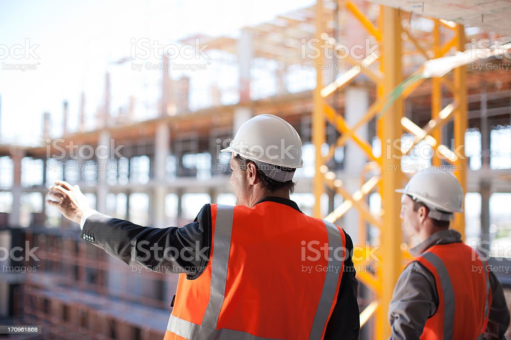 Construction workers working on construction site stock photo