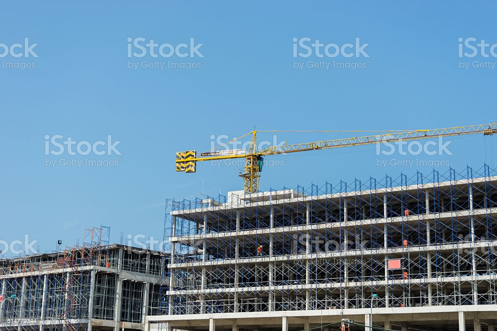 Construction workers working on scaffolding stock photo