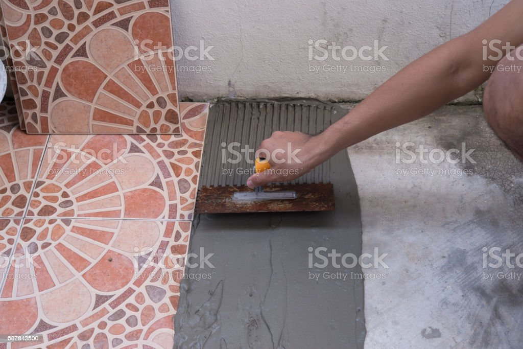 construction working Paving tiles stock photo