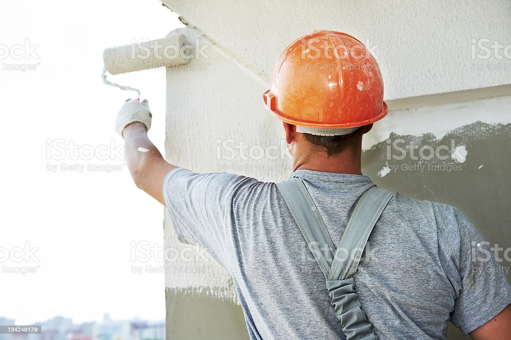 Construction working putting plaster on a wall royalty-free stock photo