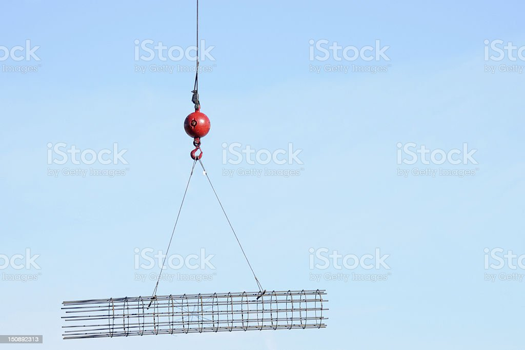 Construction wrecking ball with hook carrying steel mesh stock photo