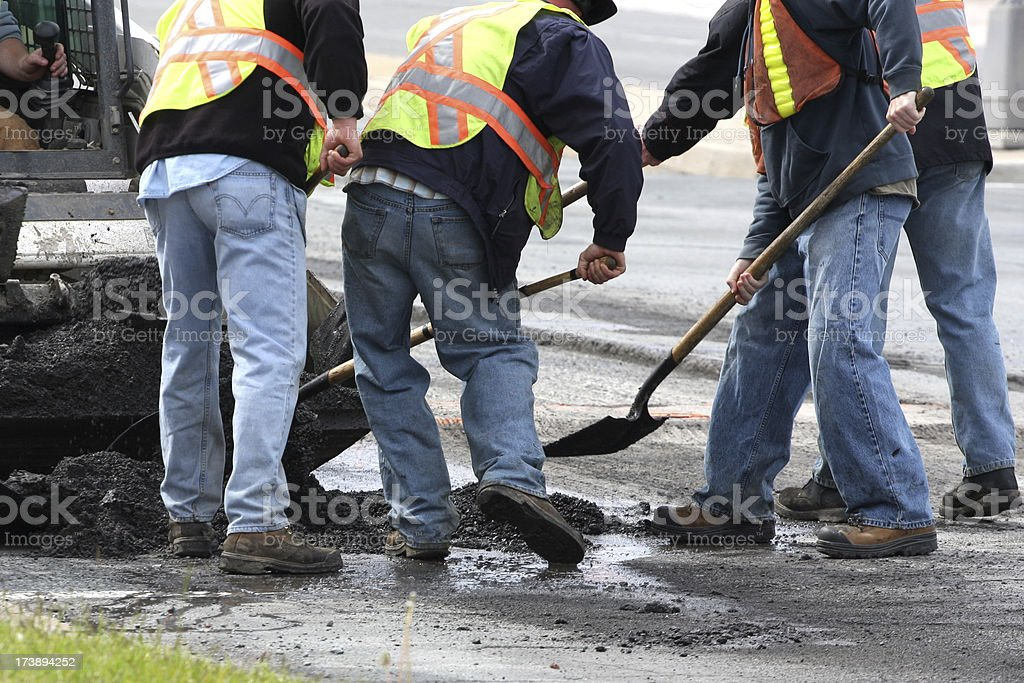 Constructions workers working on road construction stock photo