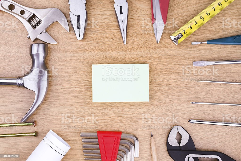 construction:Work Tools and blank note on wood stock photo