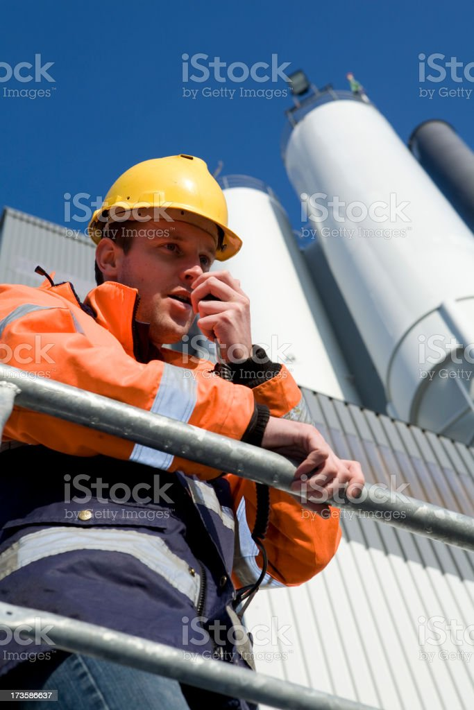 Constructionworker by factory royalty-free stock photo
