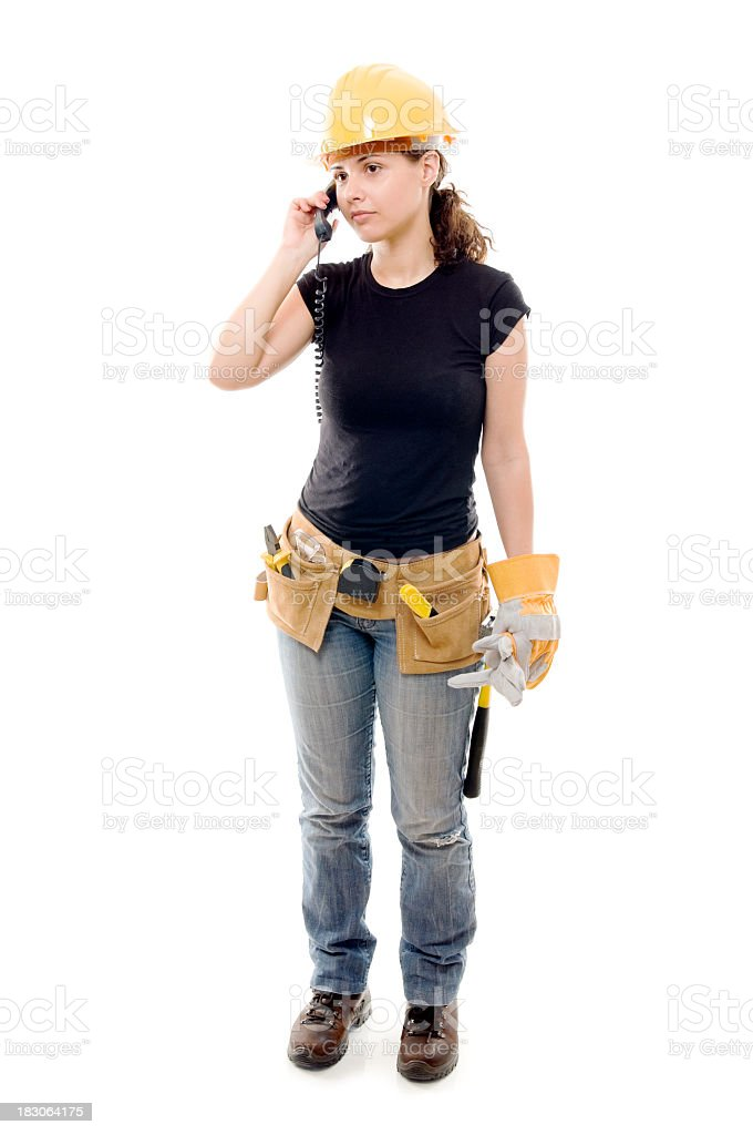 Constructor woman on the phone, isolated royalty-free stock photo