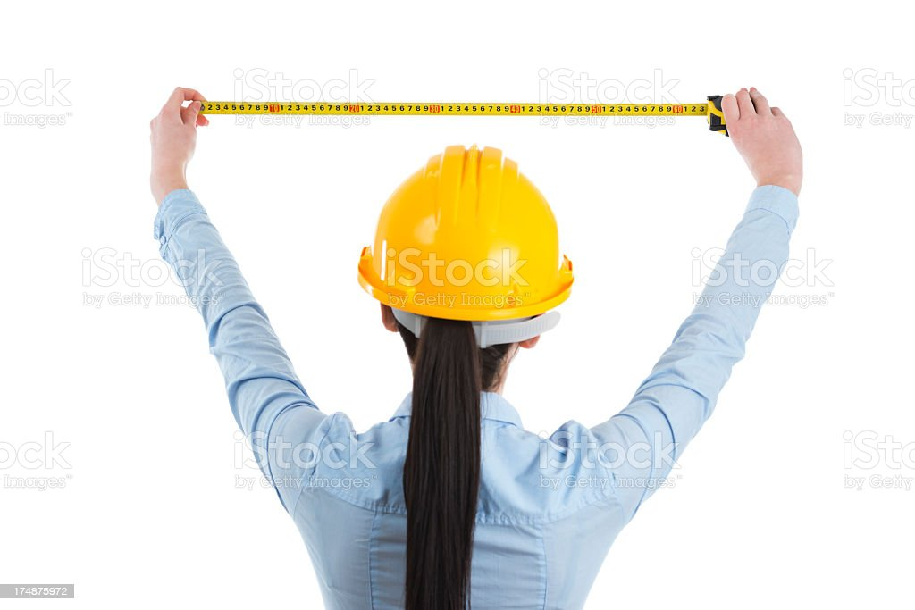 Constructor woman with measuring tape royalty-free stock photo