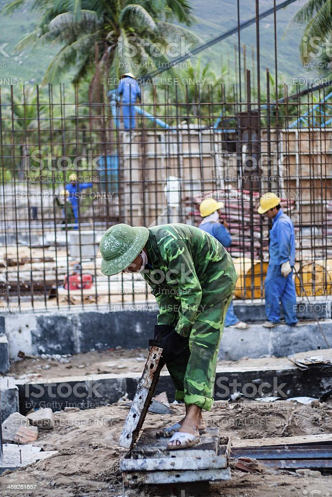 Construnction Workers in Quy Nhon, Vietnam royalty-free stock photo