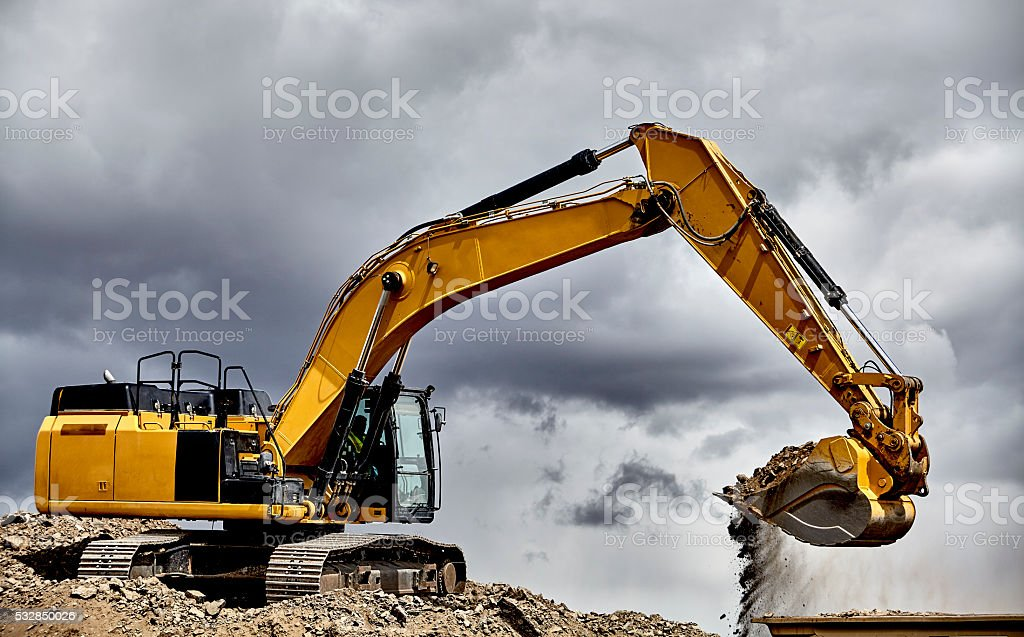 Constuction industry heavy equipment excavator loading gravel stock photo