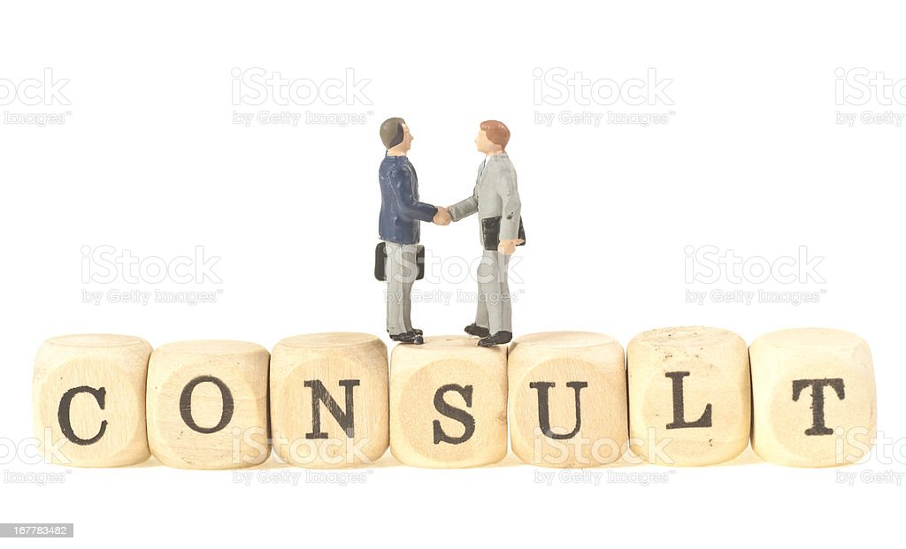 consult - abstract image with handshake stock photo