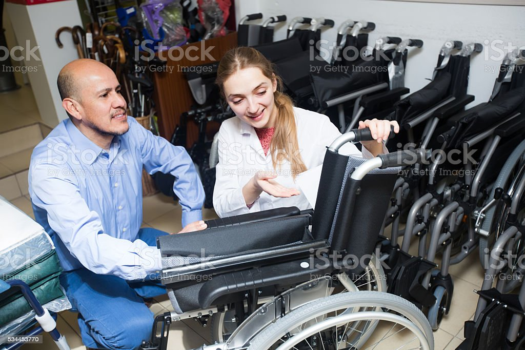 Consultant and customer in orthopaedic store stock photo