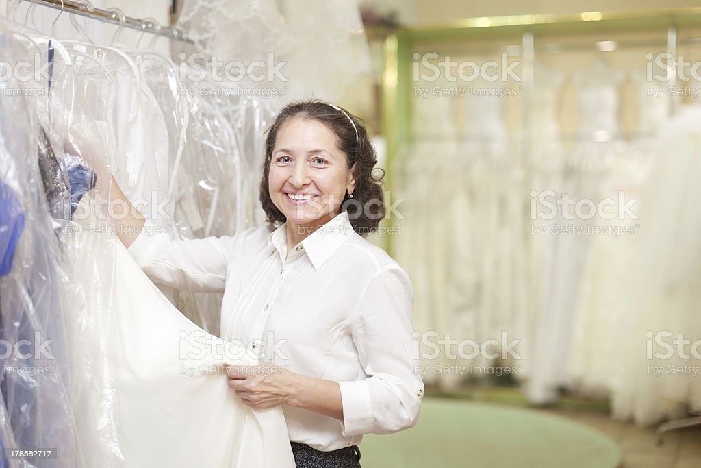 consultant  at shop of wedding fashion royalty-free stock photo