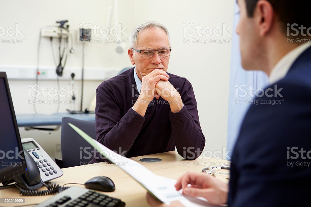 Consultant Discussing Test Results With Patient stock photo