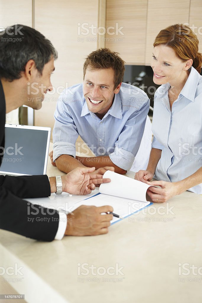 Consultant discussing with a young couple royalty-free stock photo