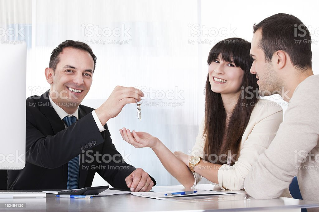 Consultant Giving Keys To Couple royalty-free stock photo