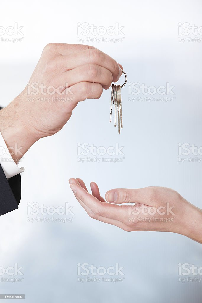 Consultant Giving Keys To Woman royalty-free stock photo
