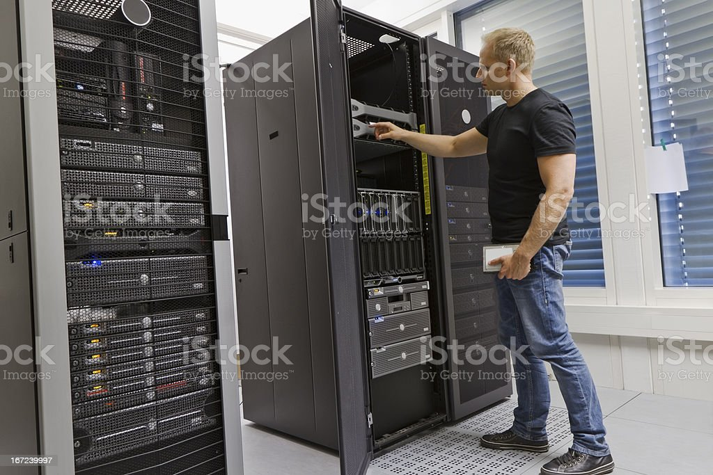 IT Consultant in a data center stock photo