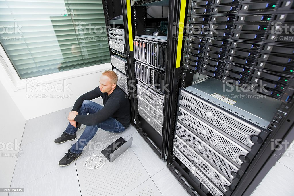 IT consultant in datacenter with tough problems stock photo