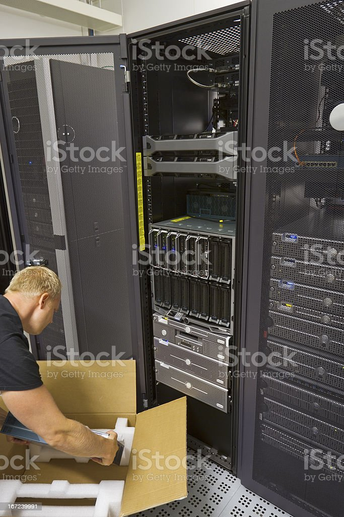 IT Consultant Installing New Router royalty-free stock photo