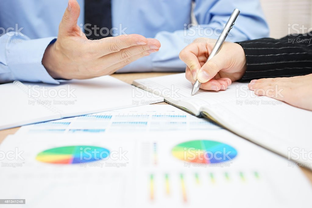 Consultant is explaining solutions to his client stock photo