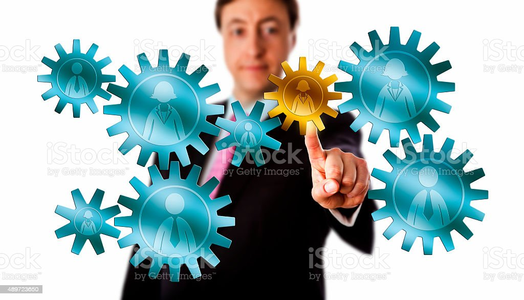 Consultant Picking A Worker Cog In A Gear Train stock photo