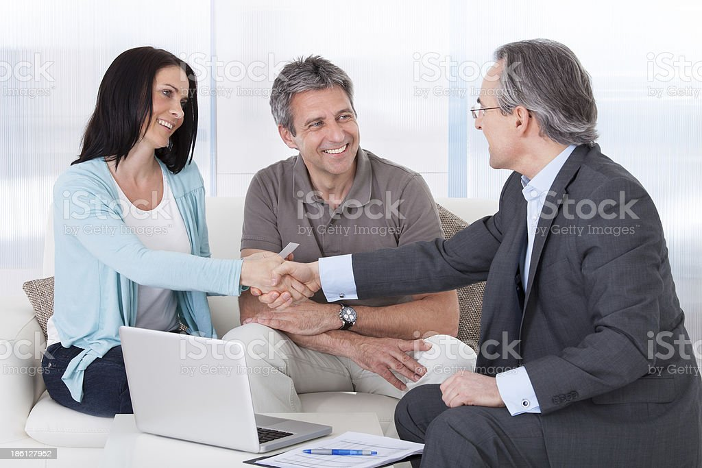 Consultant Shaking Hand With Woman stock photo