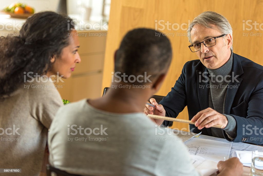 Consultant talking with couple stock photo