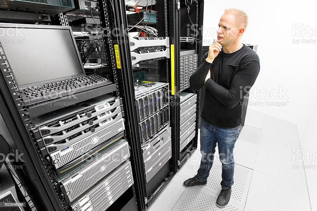 IT consultant try to solve problems in datacenter stock photo
