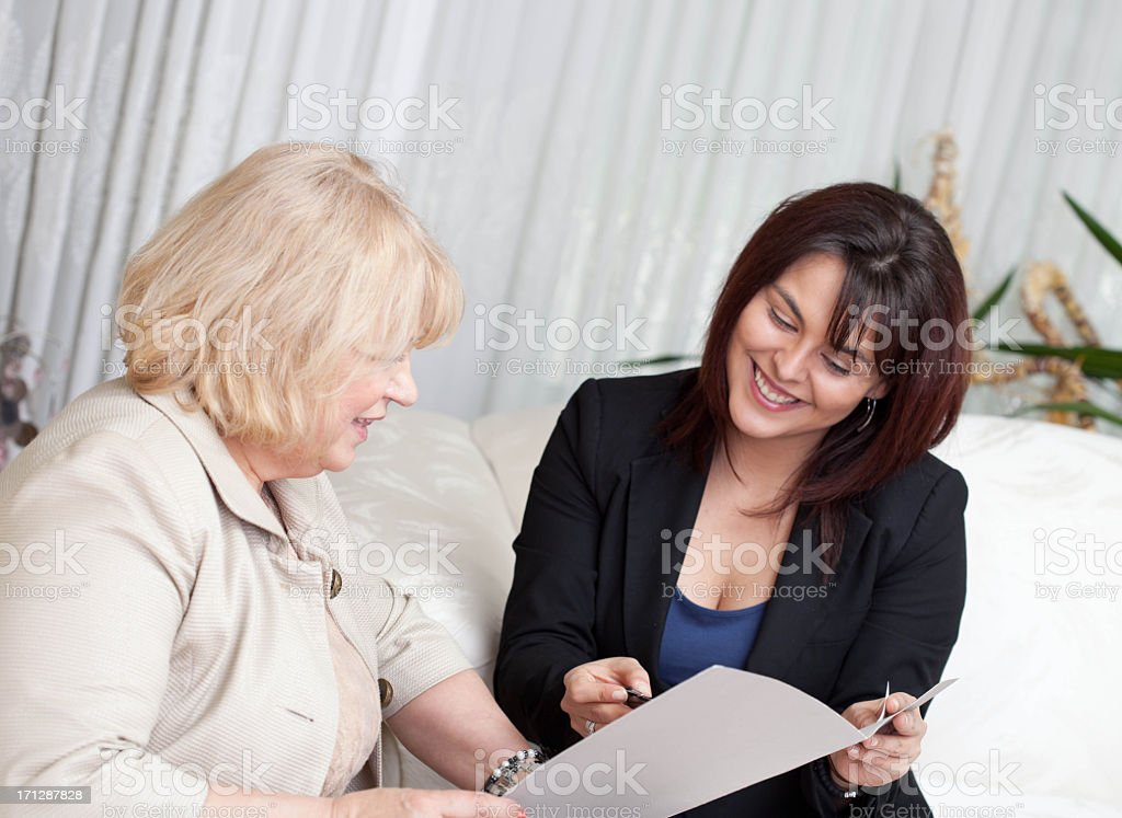 Consultant with a client reviewing documents royalty-free stock photo