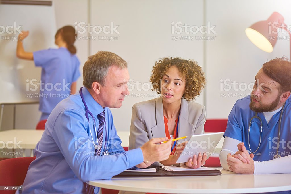 consultant with administrator stock photo